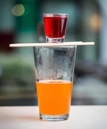A coconut campari and Fanta bomb at Hojoko, where cocktails are fun again.